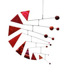 Christmas Idea - inspiration... triangles could be gifts and the balls could be homes