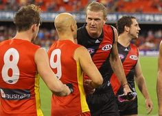 Gary Ablett of the Suns congratulates Dustin Fletcher of the Bombers after his 350th game. Photo: Getty Images