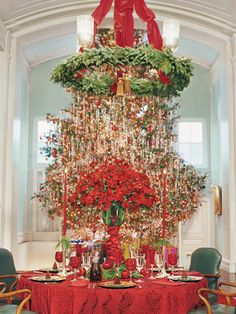 At his Manhattan design studio and showroom, designer Richard Keith Langham hosts his usual holiday dinner for eight with the table under an iron-wreath chandelier on axis with his Christmas tree. Tall Christmas Trees, Christmas Love, Beautiful Christmas, Christmas And New Year, All Things Christmas, Christmas Holidays, Merry Christmas, Xmas, Magical Christmas