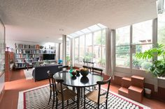 The open-plan reception/dining room spans the entire width of the house Mews House, Rural Retreats, Beautiful Interiors, Open Plan, Modern Architecture, Loft, London, Table, Reception