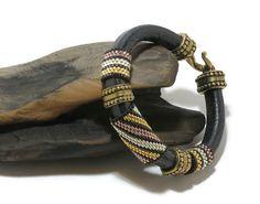 Black Regaliz leather bracelet, peyote stitched tubes, Miyuki Delicas, antique gold color spacers, hook clasp, black, gold, silver, copper