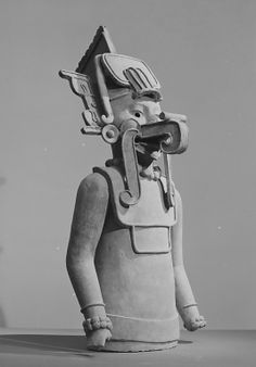 STAR GATES: AN ASTRONAUT WITH HELMET AND AIR TUBE & HEADPHONE??  Ehecatl Figure. Date: 7th–9th century Geography: Mexico, Mesoamerica, Veracruz Culture: Dimensions: H x W x D: v33 3/4 x 14 5/8 x 17 3/4in. (85.7 x 37.2 x 45.1cm) Ceramic Sculpture. The Michael C. Rockefeller Memorial Collection, Gift of Nelson A. Rockefeller, 1963 Accession Number: 1978.412.27