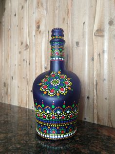 Dotted art on glass bottle using Favicryl Cone Painted Glass Bottles, Glass Bottle Crafts, Wine Bottle Art, Glass Painting Designs, Pottery Painting Designs, Dot Art Painting, Dotted Art, Mandala Art Lesson, Ceramic Flower Pots