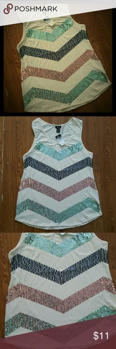 "Cute Tank Top Chevron Pearl Sequins. This is. Asuper cute tank top with a chevron pattern made out of sequins in jade, black and pink colors. The top is like a pearl color and it's  a little long. From shoulder to bottom is 28"" long. Rue 21 Tops Tank Tops"