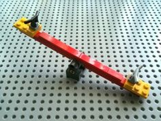 A very simple tutorial on how to create a sleek LEGO seesaw that is mini-fig friendly. The 28 parts needed for the seesaw are listed below. Check out my LEGO. Lego Duplo, Lego Moc, Hama Beads Minecraft, Lego Design, Lego Disney, Lego City, Lego Marvel, Lego Batman, Lego Poster