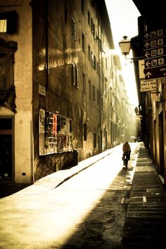 Firenze....my heart. I love, love, love this city. This photo evokes so much emotion in me.  The way the light hits in between these buildings makes me feel and smell this city and its good.
