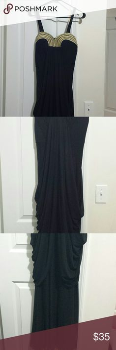 Black dress with gold detail. Roman style black dress with gold sweetheart  neckline. Size Medium  but is stretchy and will fit a large or maby extra large. Worn several times but have not dry cleaned it yet.  I will mark it low to make up  for the cleaning. Dresses Prom