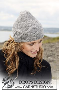 """DROPS hat with cable pattern, knitted from side to side in """"Karisma"""". Yarn alternative """"Merino"""" ~ DROPS Design"""
