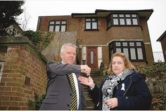 KEY TO THE DOOR:  Councillor Alison Butler gets the keys to the empty home from Francis Burton, the council's empty homes officer