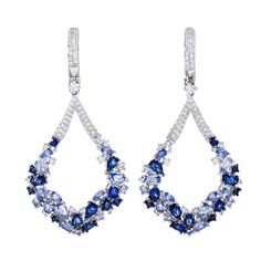 Contemporary Sapphire Diamond Drop Earrings   From a unique collection of vintage dangle earrings at http://www.1stdibs.com/jewelry/earrings/dangle-earrings/