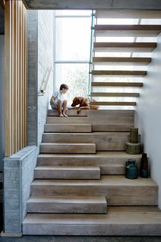 Stair love of the floor to ceiling window light balanced with the solid stairs. By Stable Marketing.
