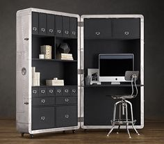 The pull out and pack-away office. Very efficient and masculine. Click thru, great site. Pls visit my blog: http://www.georgeconstance.blogspot.com