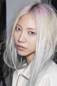 If you have dyed your hair platinum and want to do something with your incoming, darker roots, you could try chalking them pink. Like this: