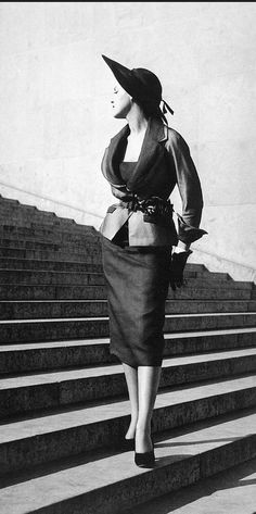 1950 Dior's coarse silk jacket with horseshoe lapels and belted over a tight-fitting sheath dress is called ''Pentecost'', photo by Willy Maywald