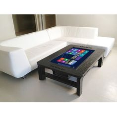 The Giant Coffee Table Touchscreen Computer - Hammacher Schlemmer BUT IF YOU SET THAT COFFEE CUP DOWN TOO HARD,YOU ARE IN TROUBLE!