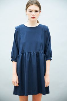 Retro vibes oozing from this Frill Panel Insert Smock Dress Navy - http://www.thewhitepepper.com/collections/dresses/products/frill-panel-insert-smock-dress-navy #TWP