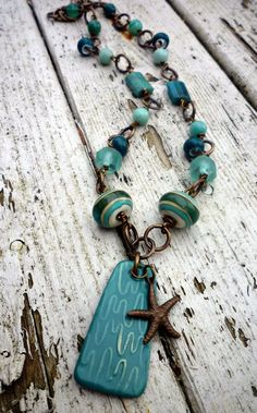 Calypso necklace. Teal, Aqua & Vintaj starfish charm. Recycled glass, Agate, Amazonite and gemstone. Published in Bead Trends Magazine.