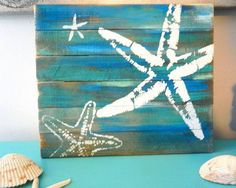 Sea Stars Pallet Art, Reclaimed wood art, Starfish art, fence art, Blue and white starfish art, marine wall art by FLACastaway on Etsy https://www.etsy.com/listing/502023402/sea-stars-pallet-art-reclaimed-wood-art
