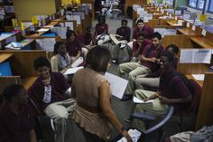 Newark Prep Charter School students listen to academic coach, Robbie Garland, while taking part in an advisory session at the school in Newark, New Jersey April 16, 2013. REUTERS/Lucas Jackson