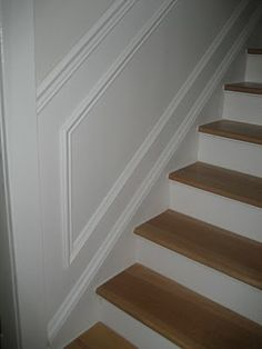 Add moulding to walls by stairs.