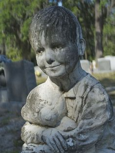 Very realistic marker - Greenwhich Cemetery, Savannah, GA.  photo by Dick Bjornseth - this one is so hard for me to look at - he looks so real and kinda sad holding his beloved teddy bear.