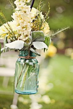 Wedding / Mason Jars, Wires, Hooks and flowers = aisle decoration.   With hydrangeas or babies breath