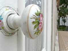 Antique porcelain doorknob with roses painted on it.