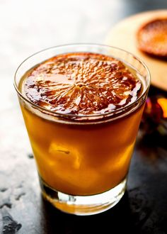 I mixed bourbon, ginger liqueur and sherry with a little fresh orange juice And in a moment of inspiration, I gussied up the orange garnish by caramelizing the slices before placing them afloat in the drinks I loved the way it looked and how it tasted