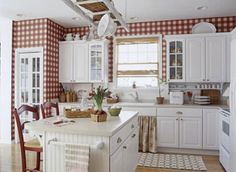 White cabinets, red accents, ladder over island...LOVE!