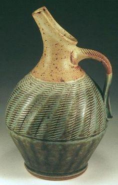 Cruet -- shape, carving and glaze