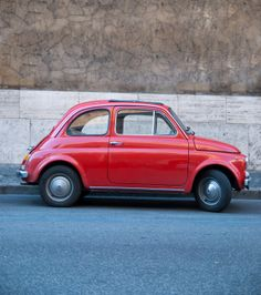 Small, compact, red old foreign vehicle