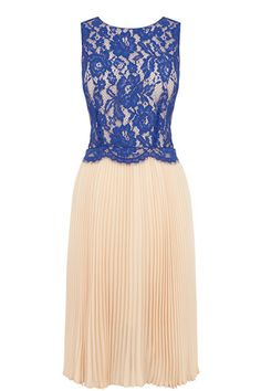 A stunning sleeveless midi dress with a lace top and a pleated skirt cinched in with a contrasting belt.