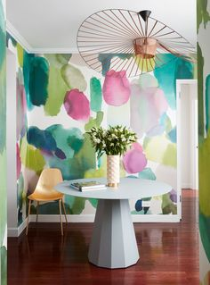 The effect of the Bluebellgray watercolor wallpaper is immediate in the foyer, which also features a gray, metal table and delicate pendant lamp—both by Parisian designer Constance Guisset Sergio_SR Pink Wallpaper Home, Watercolor Wallpaper, Interior Tropical, Tropical Home Decor, Bluebellgray, Tropical Bedrooms, Room Decor, Wall Decor, Modern Interior Design