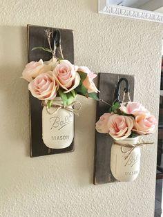 White Mason Jars on Wall Hooks