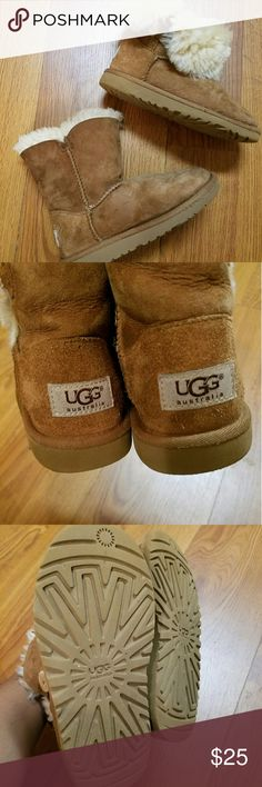 Toddler Girl UGG boots Tan Uggs for girls. See wear on the front (left shoe) and see minor small stains (right boot). Still lots of life left. UGG Shoes Boots