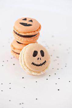 Adorable Halloween macarons with Jack-O-Lantern faces. Featured Dessert: Sprinkles for Breakfast via Lauren Conrad