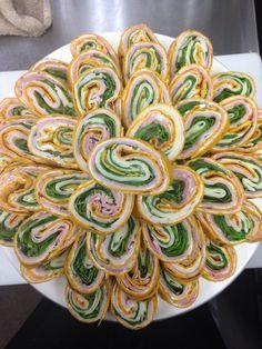 Primavera Pinwheels with ham turkey Swiss cheese honey mustard spinach herbed cream cheese on grilled tortilla