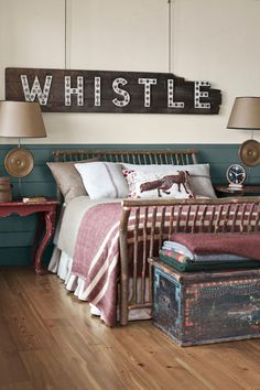 Go Vintage:  Add reclaimed and antique decor accents, like the sign, lamps, and chests in this Georgia lake house, for undone, rustic elegance.