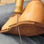 Piercing welt and outer sole with the awl.