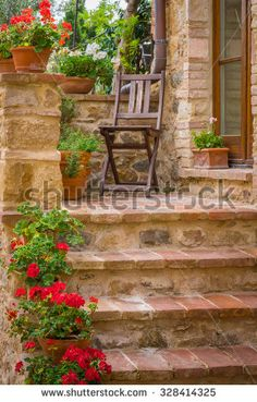 Tuscan brick house and chair in Monticchiello