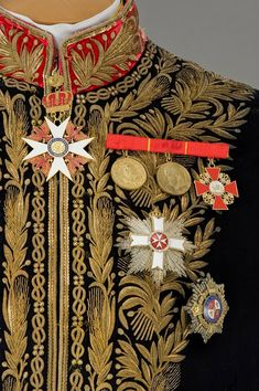 """costume diplomat from the movie """"Ludwig"""". Original men's wedding dress (1865), consisting of a black coat with a red diplomatic velvet collar and cuffs, fully embroidered with gold thread, gold thread (Gimp - a thin twisted gold or silver wire, upotr. Embroidery. Dictionaries and encyclopedias on academics) . Property company """"Tirelli."""" Photo copyright atelier """"Tirelli."""""""