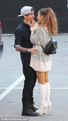 Opposites attract: Jai was wearing a black outfit with a white cap, while Ariana opted for a more neutrally-coloured outfit finished off wit...