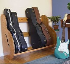 The Studio™ Deluxe Guitar Case Storage Rack is your ideal solution to keep your valued instruments safe and organized. Guitar Storage, Guitar Display, Guitar Rack, Guitar Stand, Guitar Hooks, Guitar Hanger, Music Stand, Home Music Rooms, Music Studio Room