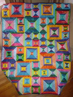 http://quiltedwithtlc.com  Lovely hand made quilts. i want to learn how to quilt so bad!