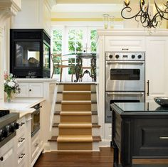 The Ultimate Cozy: Kitchen Fireplaces. Don't care for the fireplace really, but love the concept of either walking down or up into a kitchen to a dinning area or nook.