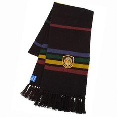 This wonderful Hogwarts wool scarf is based on the one in the Harry Potter movies. This acrylic scarf measures inches by inches. In addition, the scarf has a beautiful Hogwarts House patch on one end. For children ages 5 and up as well as adults. Harry Potter Scarf, Harry Potter Shop, Harry Potter Movies, Harry Potter Hogwarts, Potter School, Hogwarts Houses, Winter Accessories, Wool Scarf, Warner Bros