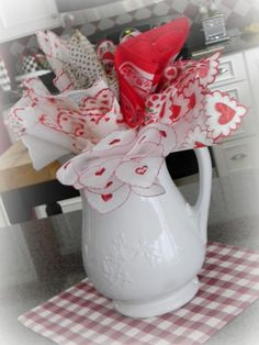 Antique pitcher with starched Vintage Valentine hankies stuffed inside!