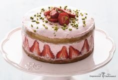 Strawberry Coconut Flour Cake features nourishing coconut flour and a refined-sugar-free Strawberry Buttercream.