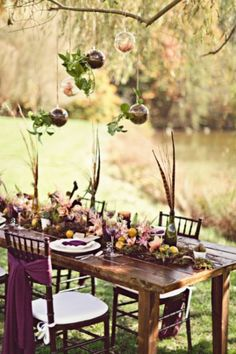 Boho wedding. Love the pheasant feathers in wine bottles as part of the centerpieces