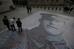 A digital mosaic of a photograph of British Army private James Ernest Beaney, killed in France in 1916 during the first world war. The portrait was created by artist Helen Marshall as people pay their respects to the fallen